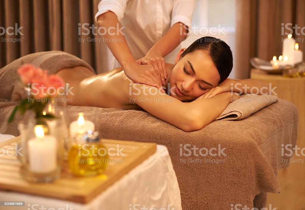 Indulging her senses at the spa stock photo