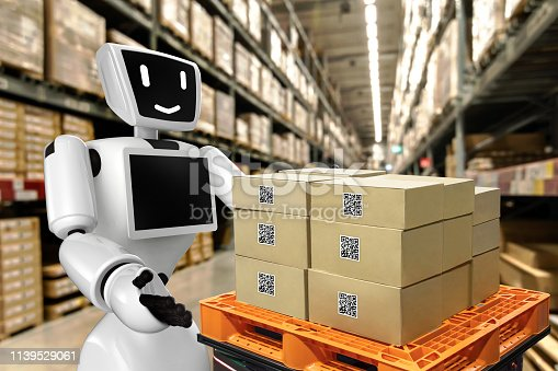 istock Industrial 4.0 , Augmented reality and 3d robot smart logistic concept. Hand holding tablet with AR application for check order pick time around the world and supply chain in smart factory background. 1139529061