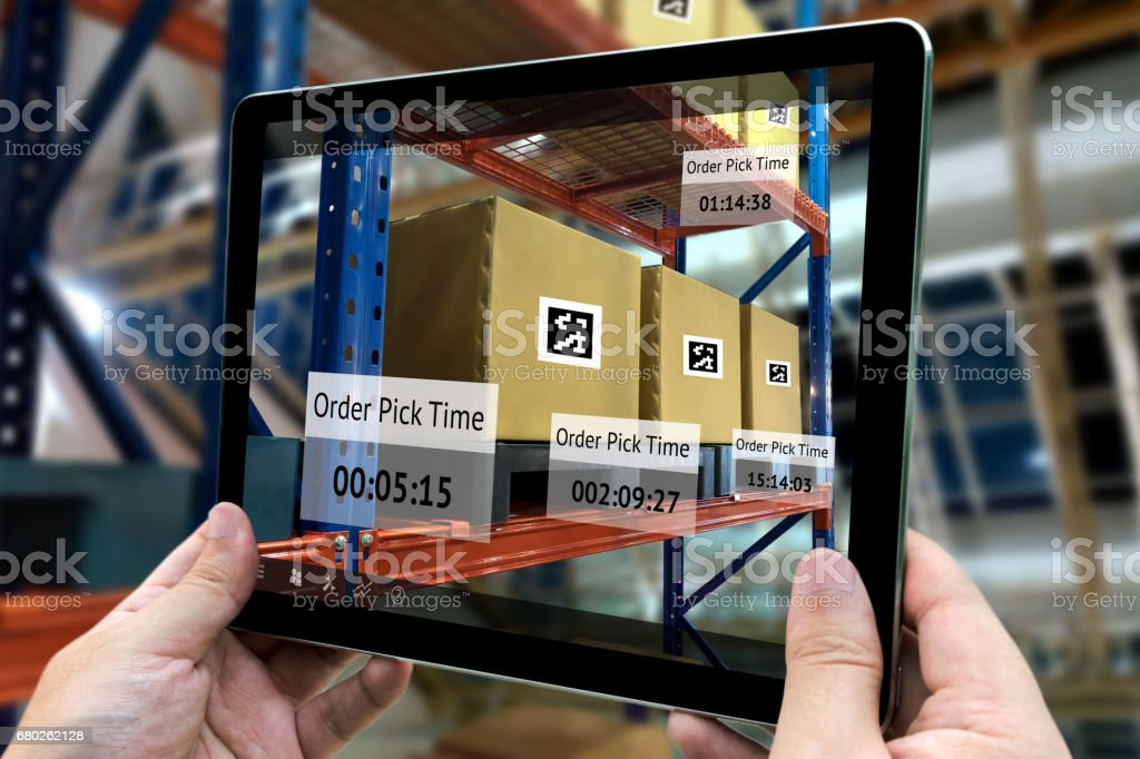 Industrial 4.0 , Augmented reality and smart logistic concept. Hand...