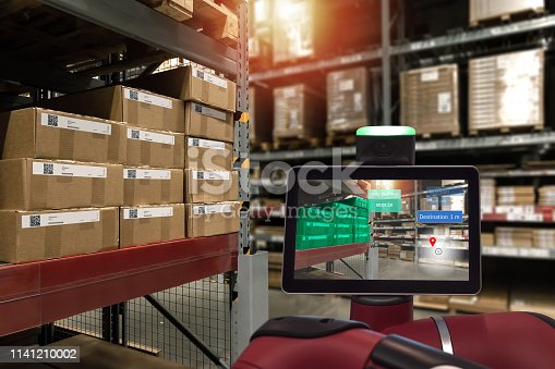 istock Industrial 4.0 , Augmented reality and smart logistic concept. Robot adviser with AR application for check order pick time in smart factory industry warehouse. 1141210002