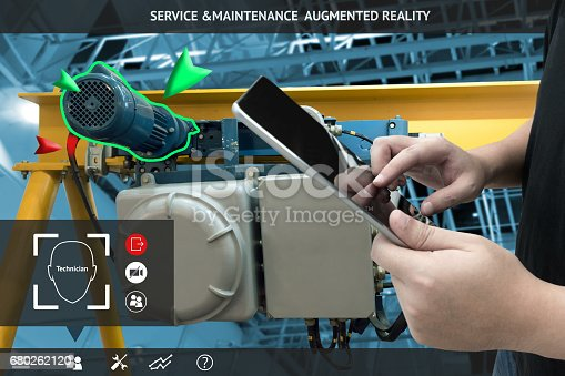 istock Industrial 4.0 , Augmented reality concept. Hand holding tablet with AR service , maintenance application and calling technician for check destroy part of smart machine in smart factory background 680262120