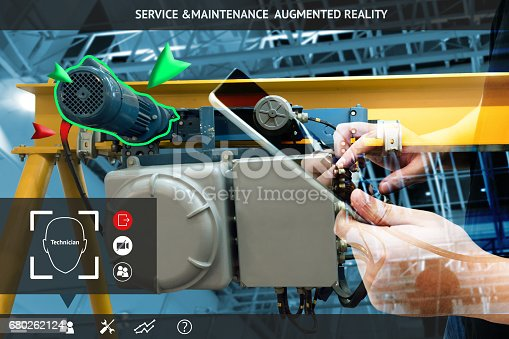 istock Industrial 4.0 , Augmented reality concept. Hand holding tablet with AR service , maintenance application and calling technician for check destroy part of smart machine in smart factory background 680262124