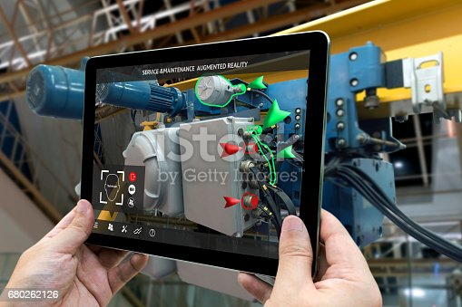 istock Industrial 4.0 , Augmented reality concept. Hand holding tablet with AR service , maintenance application and calling technician for check destroy part of smart machine in smart factory background 680262126