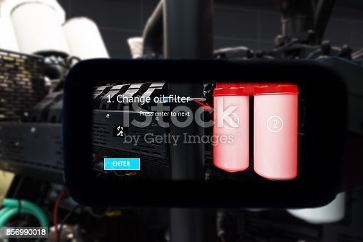 istock Industrial 4.0 , smart helmet technology concept. Augmented reality glasses service. Engineering monitoring ,maintenance and change oil filter to ensure accurate operation in smart factory background 856990018
