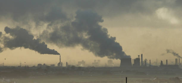 industrial air pollution - factories near middlesbrough releasing smoke in the environment - pollution stock pictures, royalty-free photos & images