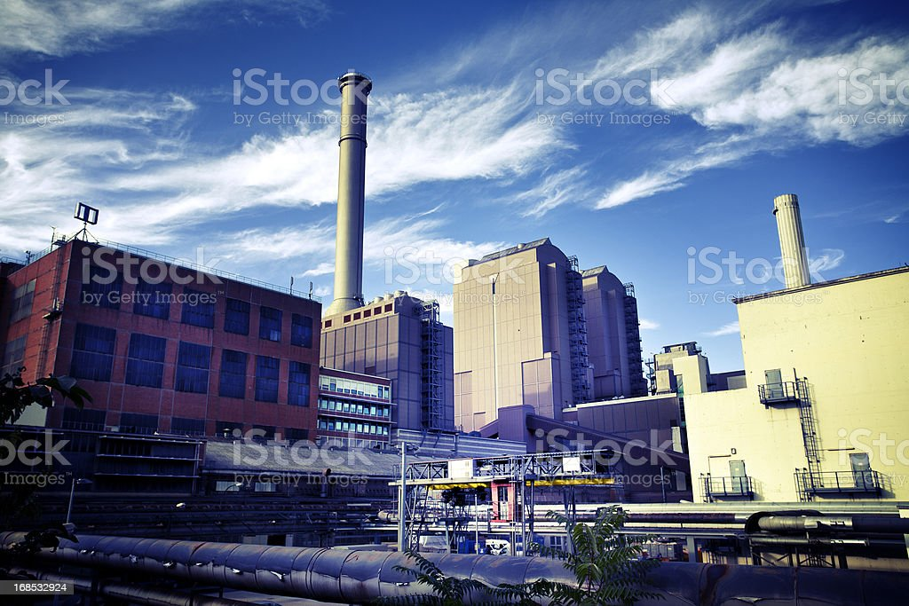 Industrial area against dramatic sky royalty-free stock photo