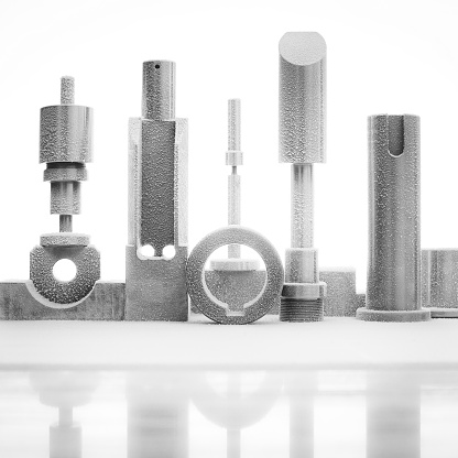 Stainless steel parts with particular forms arranged in an architectural way like a modern sculpture. All parts are manufactured on demand for a prototype machinery. The steel parts are frozen.