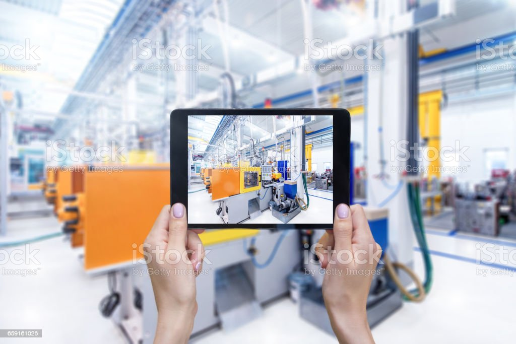 Industrial automated machines & tablet stock photo