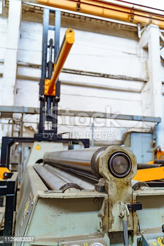 istock Industrial background from metal parts produced in metal industry. 1129683537