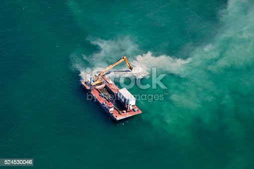 Industrial Barge with an Excavator on the Sea