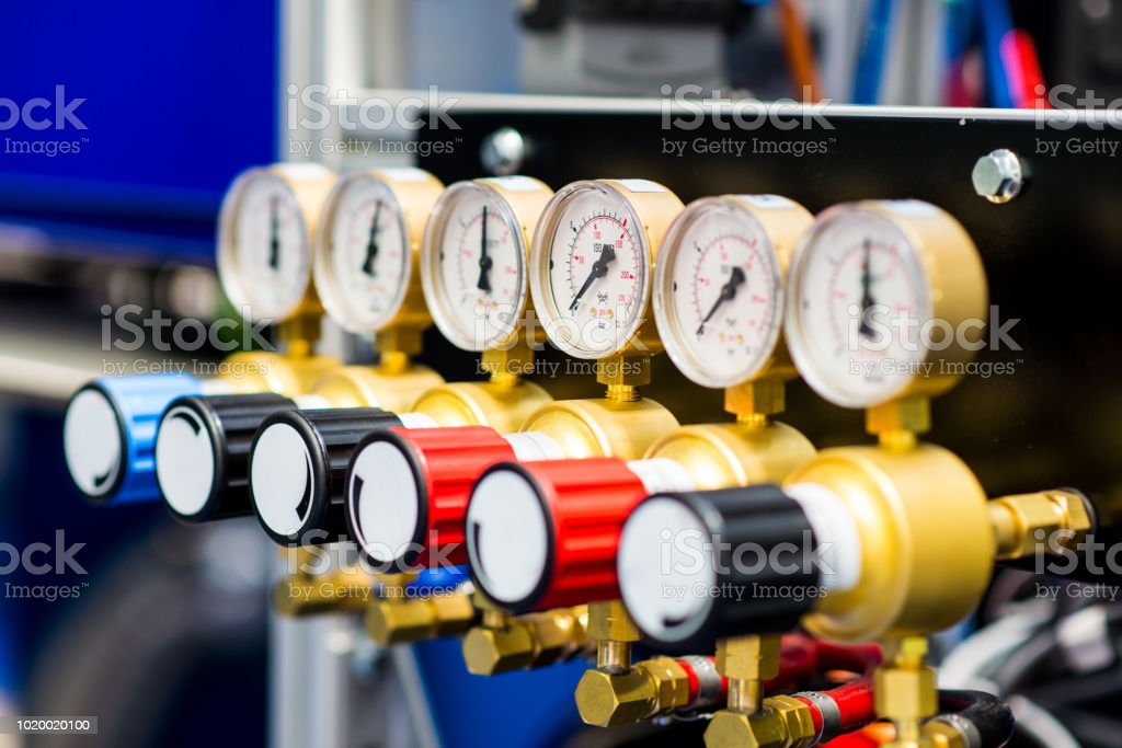 Industrial barometers on gas pipes stock photo