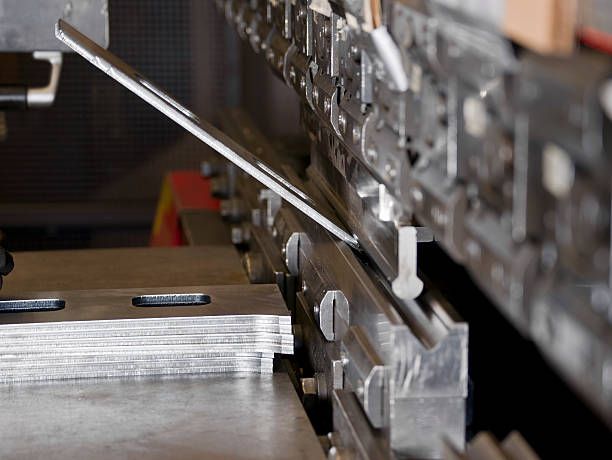 CNC Industrial brake press in use A photograph of an industrial hydraulic brake press bending a sheet steel component.  Brake presses are manufacturing tools used to bend metal.For other industrial images please visit: bending stock pictures, royalty-free photos & images