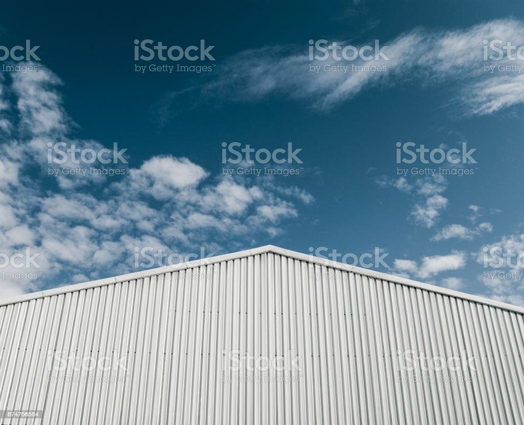 Industrial building with corrugated sheet metal facade stock photo