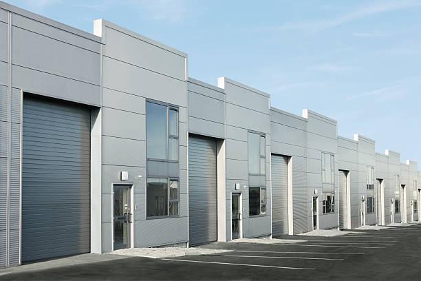 budynki przemysłowe - magazyn budynek przemysłowy zdjęcia i obrazy z banku zdjęć