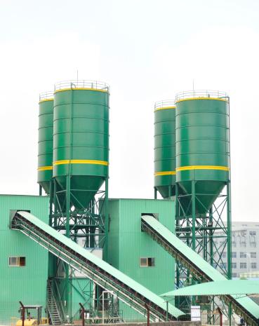 green processing silos of a concrete factory
