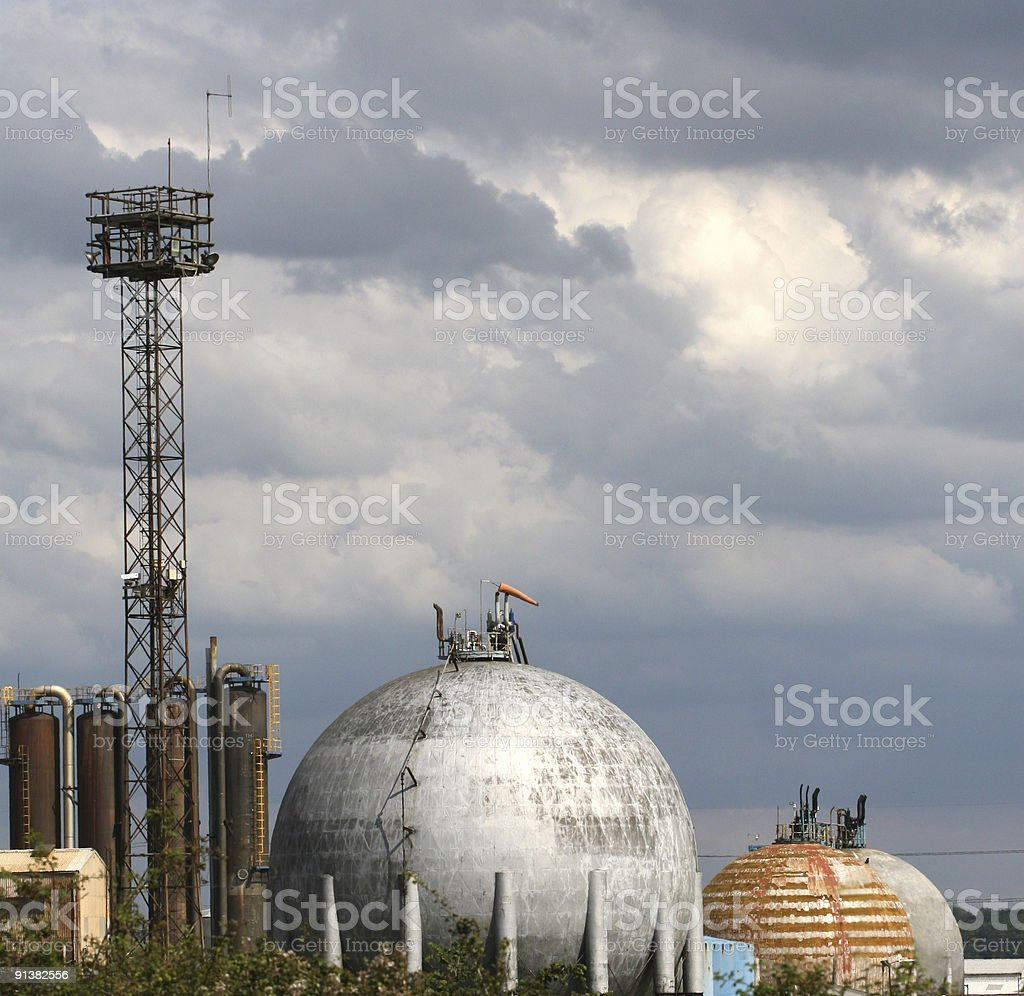 Industrial chemical works against cloudy sky royalty-free stock photo