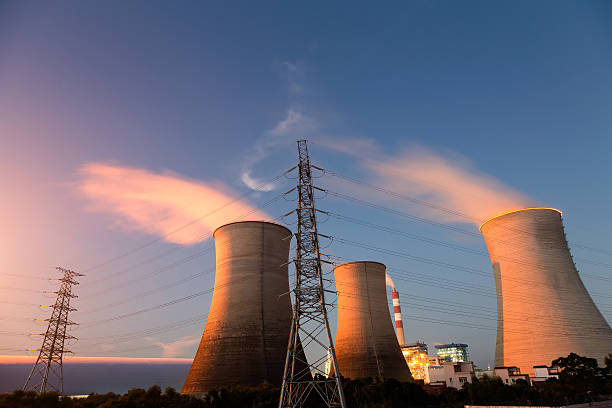 industrial chimney - cogeneration plant stock photos and pictures