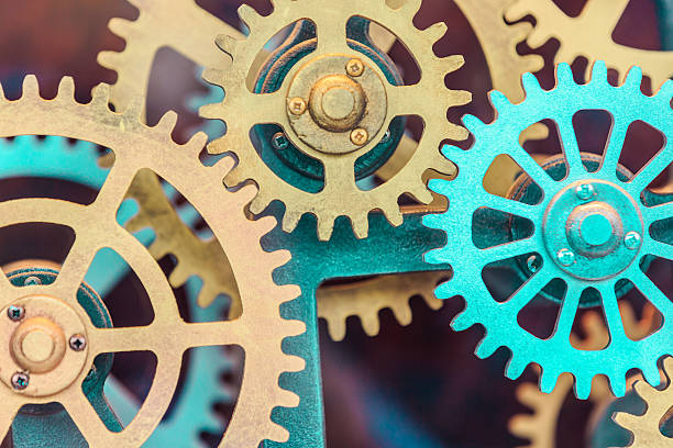 industrial clock gear set background - cog stock photos and pictures
