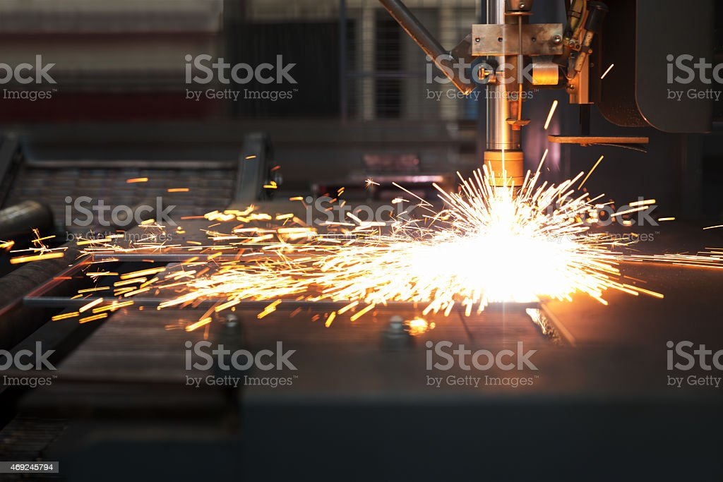 Industrial cnc plasma machine cutting of metal plate stock photo