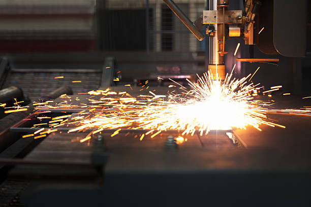 Industrial cnc plasma machine cutting of metal plate
