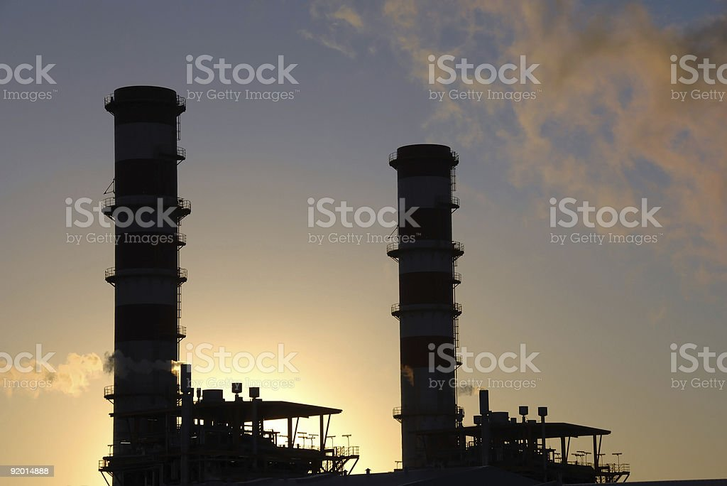 Industrial complex plant at sunset royalty-free stock photo