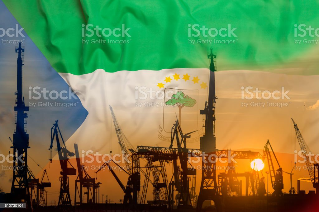 Industrial concept with Equatorial Guinea flag at sunset stock photo