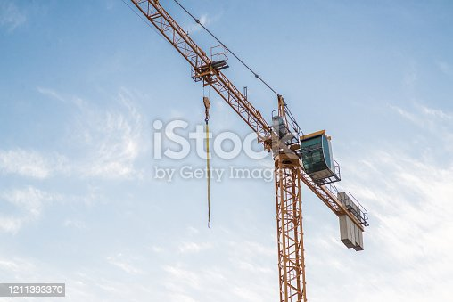 Industrial Construction Crane on Blue Sky Background. Sky with Clouds.