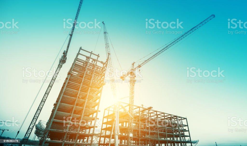 Industrial construction cranes stock photo