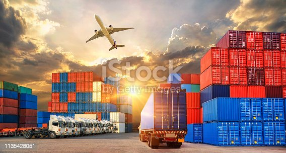 istock Industrial Container Cargo freight ship, forklift handling container box loading for logistic import export and transport industry concept backgroundtransport industry background 1135428051