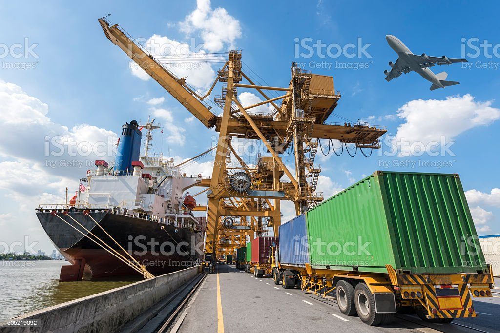 Industrial Container Cargo freight ship with working crane bridg stock photo