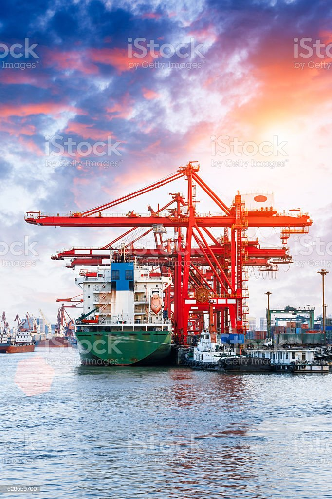 Industrial container freight Trade Port scene at sunset stock photo