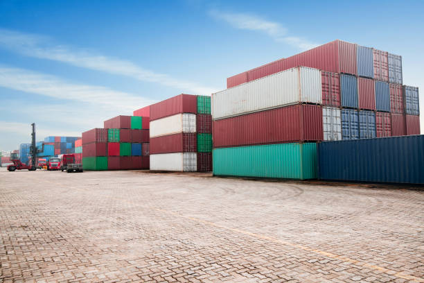 industrial container yard for logistic import export business - container foto e immagini stock