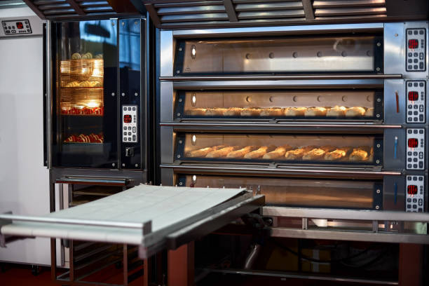 Industrial convection oven with cooked bakery products for catering. Professional kitchen equipment Industrial convection oven with cooked bakery products for catering. Professional kitchen equipment, Professional industrial equipment. oven stock pictures, royalty-free photos & images