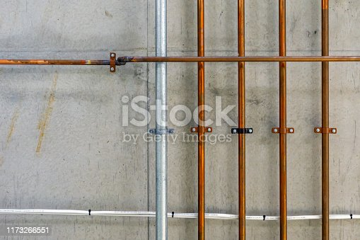 Industrial Copper Pipework In Ceiling Of Construction Space