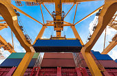 Industrial crane loading Containers in a Cargo