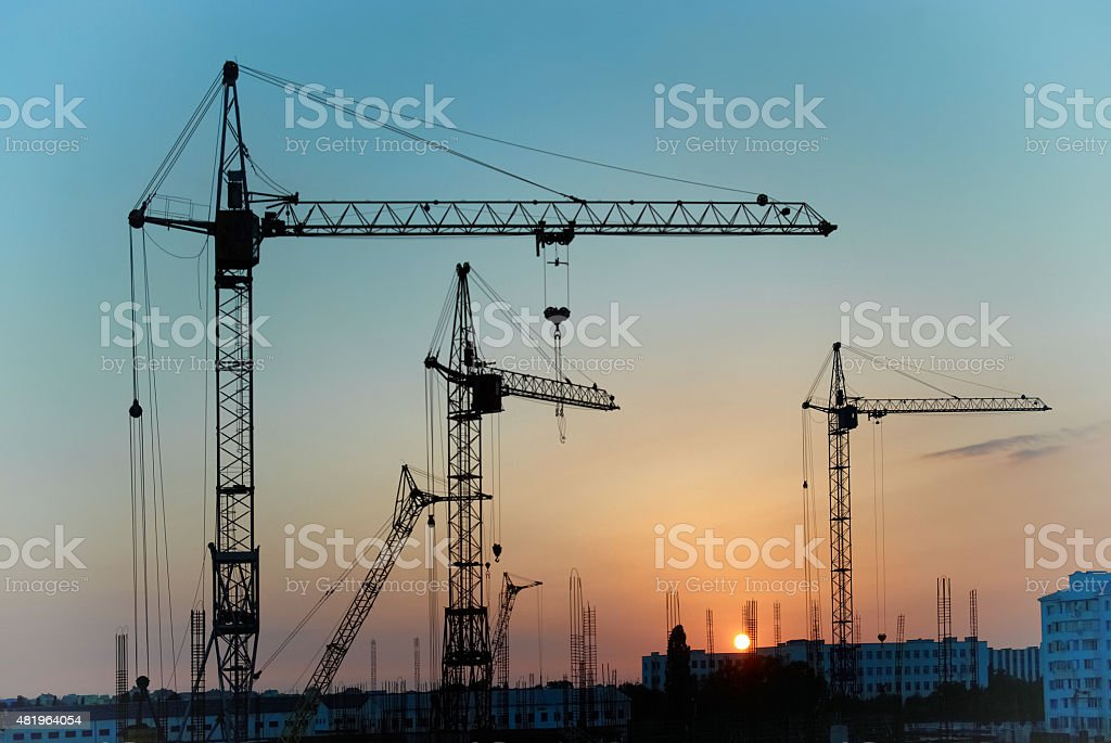 Industrial cranes stock photo