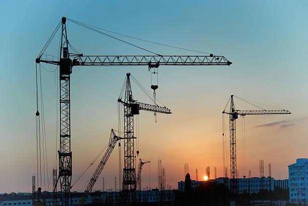 Industrial cranes stock photo