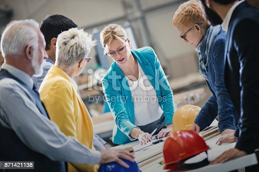 istock Industrial design team in a meeting. 871421138