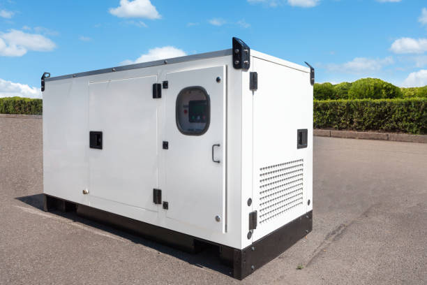 Industrial Diesel Generator. Standby generator. Industrial Diesel Generator for Office Building connected to the Control Panel with Cable Wire. Backup Generator Power. stock photo