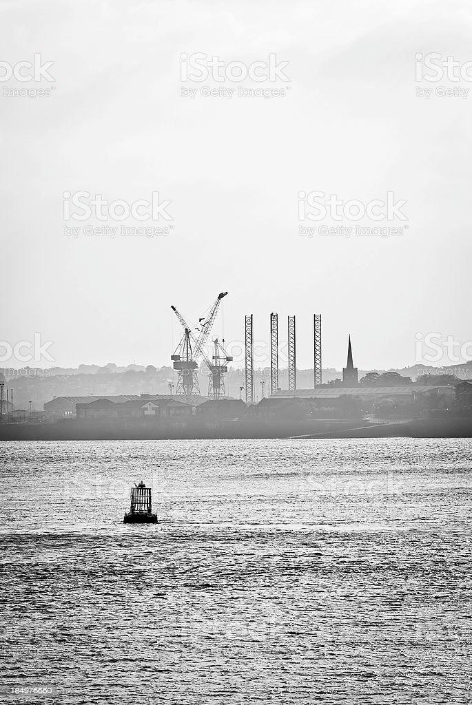 Industrial dock cranes in Birkenhead, foggy silhouette stock photo