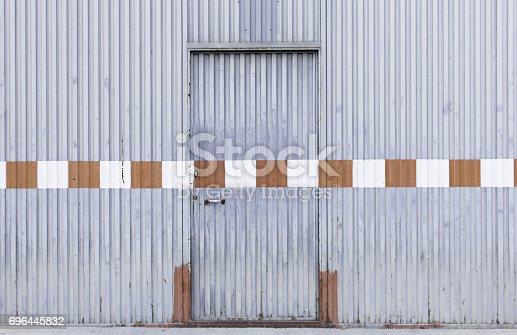 826150670istockphoto Industrial door metal 696445832