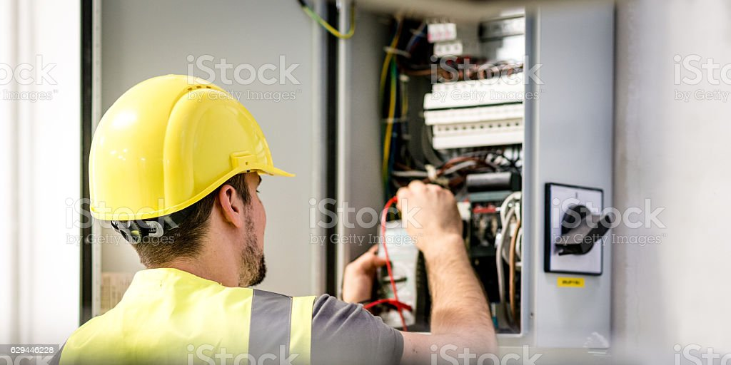 Industrial electric panel repair stock photo