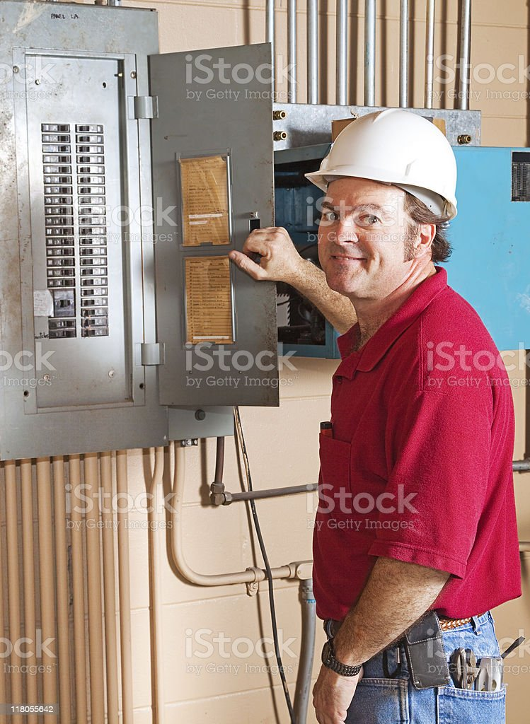 Industrial Electrician at Work royalty-free stock photo