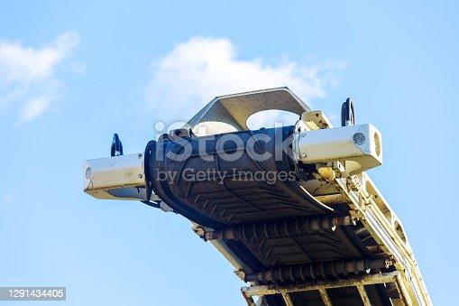 Industrial work machine elevator crushed stone transportation
