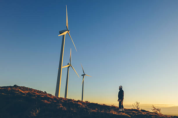 Industrial engineer in a windfarm. stock photo