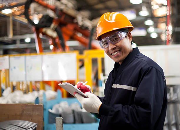 industrial engineer - manufacturing occupation stock photos and pictures