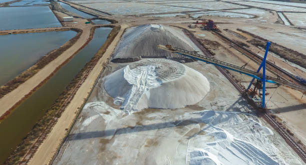 Industrial extraction of sea salt by evaporation. Industrial extraction of sea salt by evaporation. Aerial view. evaporation stock pictures, royalty-free photos & images