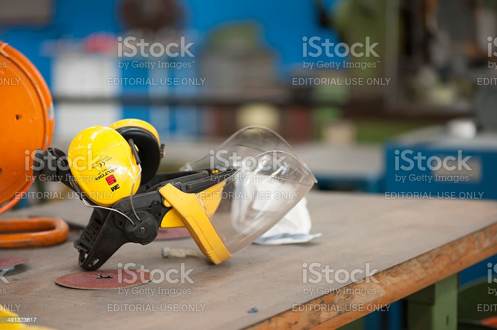 Industrial face protection equipment on a workbench stock photo