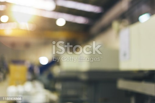 Blurred and abstract industrial factory and machinery production line background