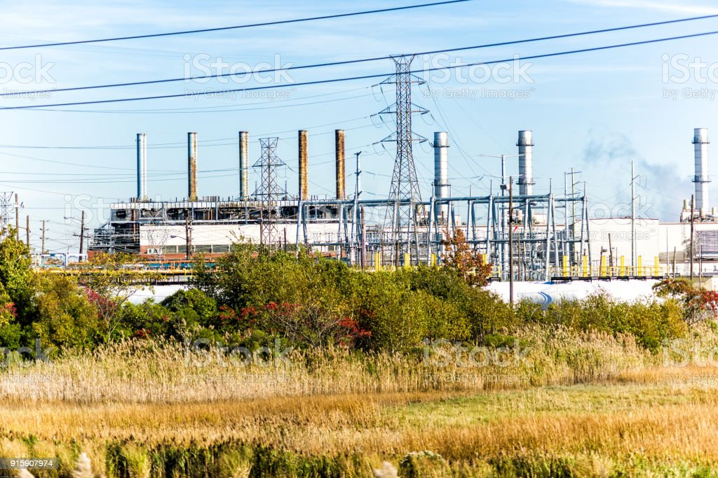 Industrial factory in Delaware or New Jersey with pipeline pollution, refinery plant for processing exterior, pipes stock photo